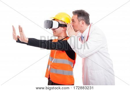 Constructor Gesturing Wearing Virtual Reality Glasses With Doctor Whispering