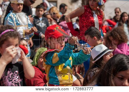 Happy People Celebrate The Purim Holiday At Street Event