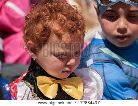 Redhead Jewish Girl Celebrate The Purim Holiday At Street Event
