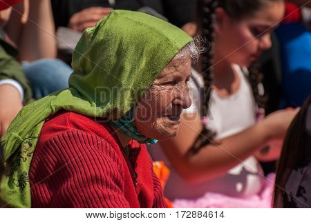 Very Elderly Woman Celebrate The Purim Holiday At Street Event