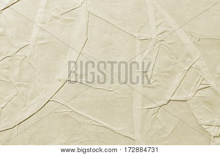 Sepia crumpled grained paper for texture or background.