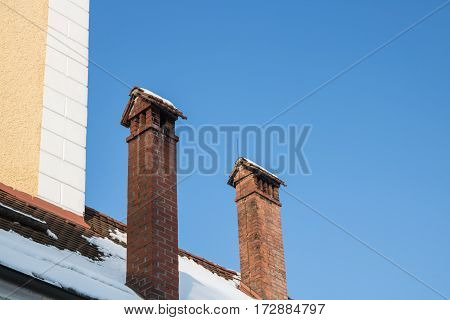Chimney on house. red Roof and red brick