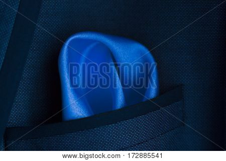 close up of a blue handkerchief in a pocket