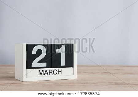March 21st. Day 21 of month, wooden color calendar on white background. Spring time, empty space for text.