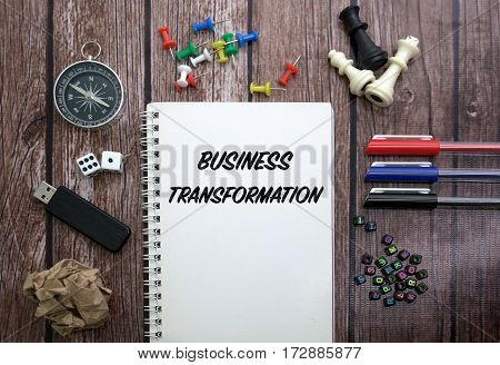 Business Transformation CONCEPT ON NOTEBOOK WITH STATIONERY