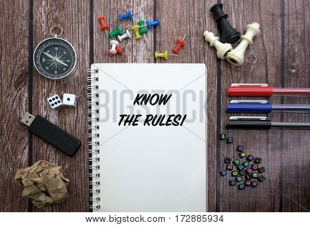 KNOW THE RULES! CONCEPT ON NOTEBOOK WITH STATIONERY