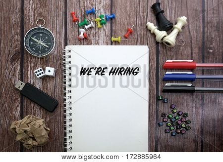 WE'RE HIRING CONCEPT ON NOTEBOOK WITH STATIONERY