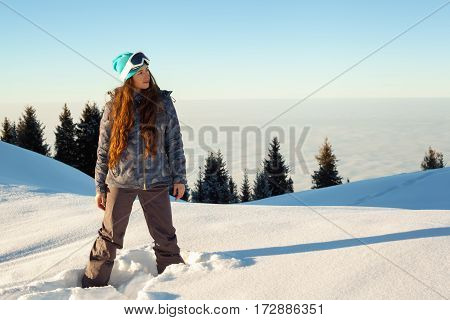 Girl Stands Mountain Top At Sunset
