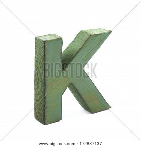 Single sawn wooden letter K symbol coated with paint isolated over the white background