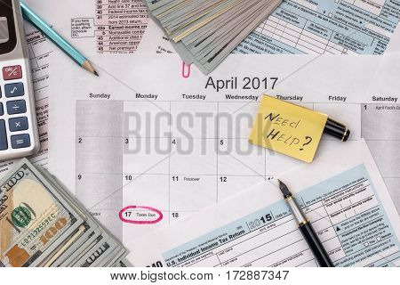 Tax Form With Pen, Calendar, Money On Desk