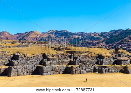 Inca Wall in SAQSAYWAMAN Peru South America. Example of polygonal masonry. The famous 32 angles stone in ancient Inca architecture.