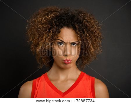 Portrait of a beautiful African American woman with a suspicious expression
