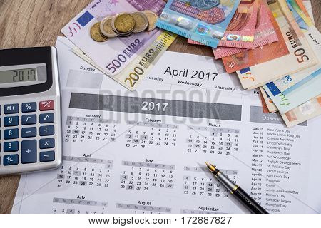 euros banknote with calendar and calculator. close up