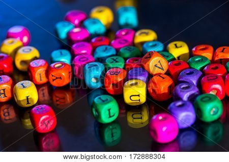 many colored wooden blocks for learning words. pre-school education.
