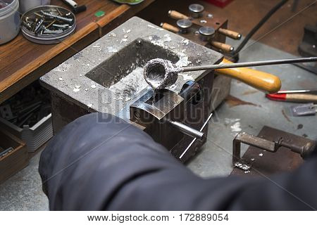Pouring molten lead alloy into a mold. Workshop. Craftsman plant produces components for the machines. Manufactory, manual manufacturing of lead alloy .An employee at the plant craft while working.