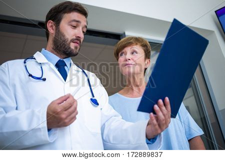 Doctor and patient discussing over report in hospital waiting room