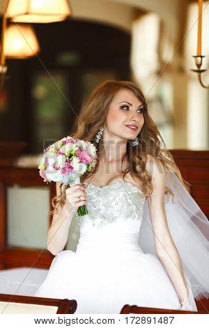 Amazing Bride Turns Around Standing In A Restaurant's Hall