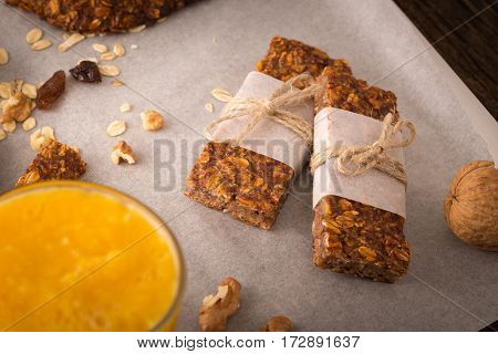 Cereal Bars With Raisins, Nuts And Orange Juice.