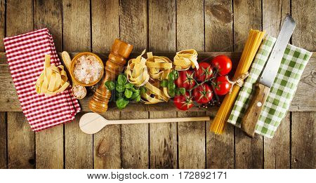 Tasty Colorful Fresh Italian Food Concept with Various Pasta Spaghetti Fresh Basil Tomatoes Spices. Cooking Concept. Place for Text.