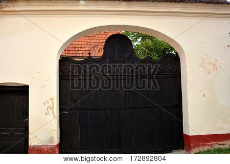 Gate of a typical houses in the village Vulcan (German: Wolkendorf), a commune in Brasov County in the centre of Romania, 16 km west of the county capital Brasov.