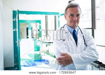 Portrait of doctor standing with arms crossed at the hospital