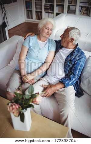 Senior couple sitting and interacting with each other at home