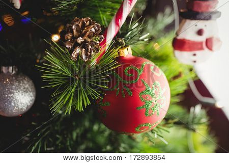 Close-up of decorations on christmas tree during christmas time at home