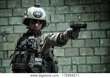 US Army Ranger aiming pistol with one hand