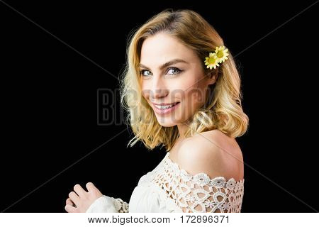 Close-up of beautiful smiling woman against black background