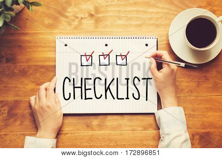 Checklist Text With A Person Holding A Pen