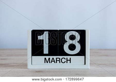 March 18th. Image of march 18 wooden color calendar on white background. Spring day, empty space for text. World Sleep Day.