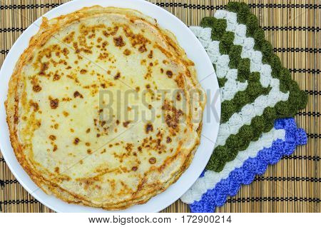 hot fried pancakes on a white circular plate