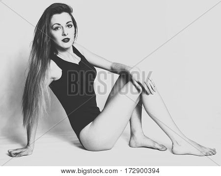 Girl with long hair posing in studio. Black and white photography