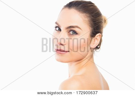 Close-up of beautiful woman posing against white background