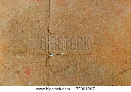 Grunge vintage damaged paper with space for text.
