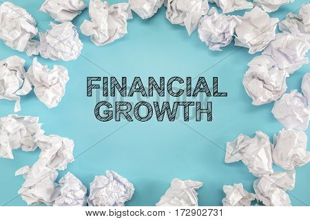 Financial Growth Text With Crumpled Paper Balls