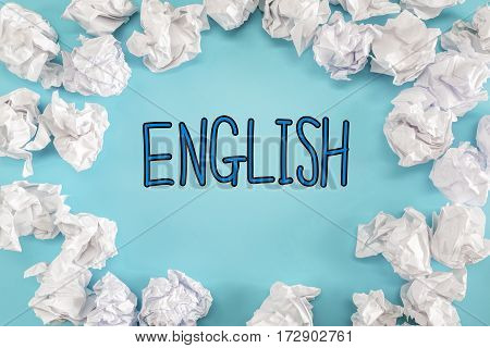 English Text With Crumpled Paper Balls