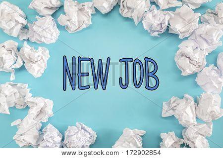 New Job Text With Crumpled Paper Balls