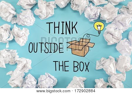 Think Outside The Box Text With Crumpled Paper Balls