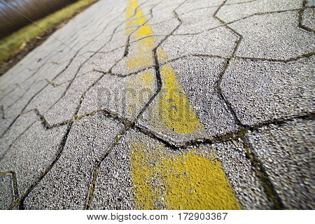 Speed and distance concept - cycle path closeup with a yellow line