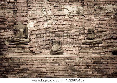 Broken of Buddha statue stone at Ayuthaya Thailand