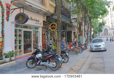 HANOI VIETNAM - NOVEMBER 22, 2016: Unidenyified people visit Nha Tho shopping street. Nha Tho street is famous for boutiques and cafes.