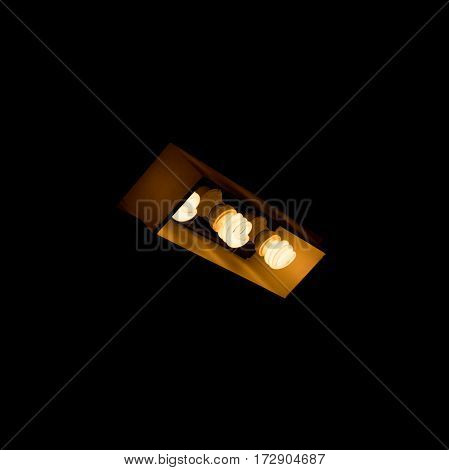 Three bulbs in lamp shade. Abstract of light.