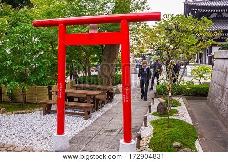 KAMAKURA, JAPAN - NOVEMBER 10, 2016: Torii gate at Hase-dera temple in Kamakura, Japan. Hase-dera Buddhist temple is famous for housing a massive wooden statue of Kannon.