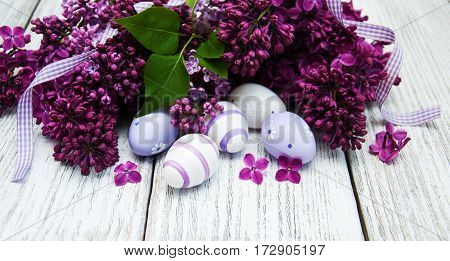 Easter Eggs And Fresh Lilac Flowers