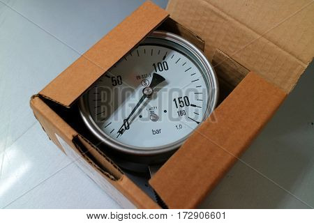 New pressure gauge is in the carton box.