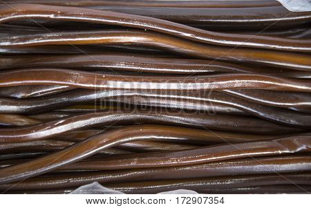 Choco flavoredl twisted licorice candies as a background