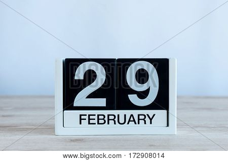 February 29th. Cube calendar for february 29 on wooden surface with empty space for text. Leap year, intercalary day.