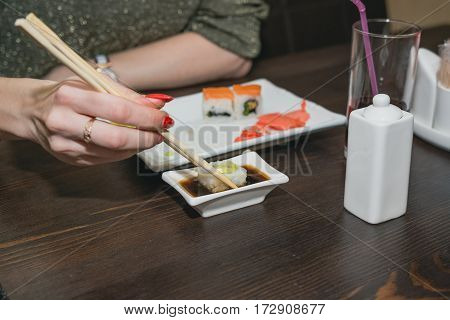 The Girl Eats Sushi, The Japanese Sticks At The Japanese Restaurant.