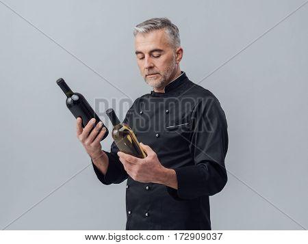 Chef Choosing A Wine Bottle